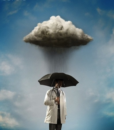 Doctor under raincloud