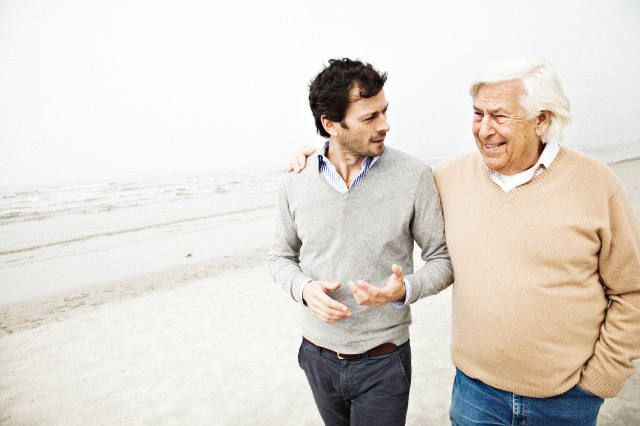 Father and son talking on beach